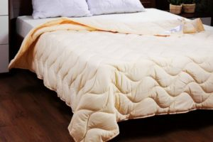 Как выбрать одеяло по наполнителю на все сезоны